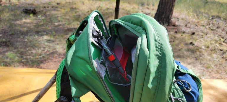 The dedicated hydration pocket, opened and revealing the 2.5 liter water bladder that comes with the Osprey Manta 24 backpack.