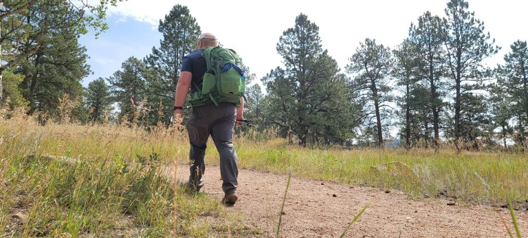 Me wearing my Osprey Manta 24 backpack and walking down the path.