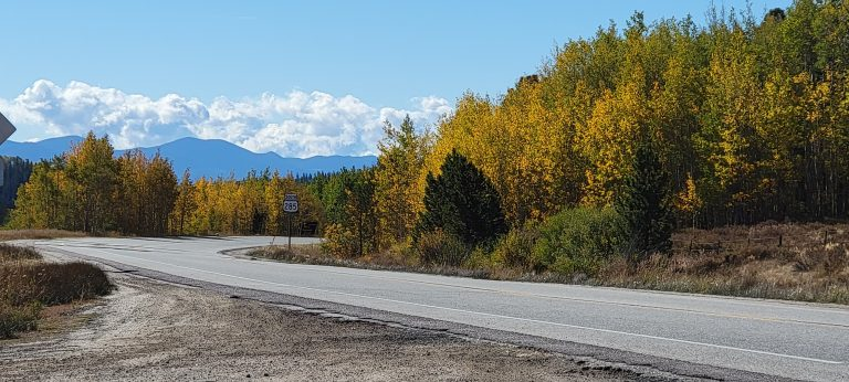 The 285 road sign surrounded by the Fall Colors of Colorado at Kenosha Pass.