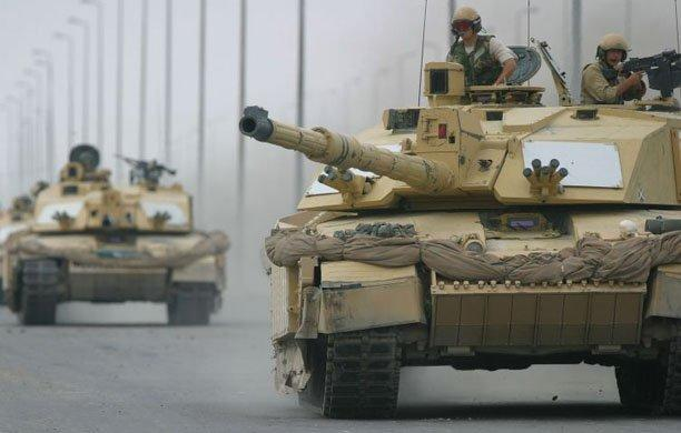 British Challenger 2 tanks move through Basra, Iraq. Pool photo by Dan Chung