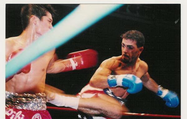 Bilam Spin kicks an opponent