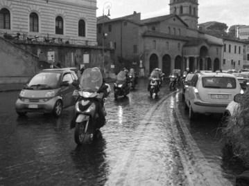 Vespas everywhere! Crossing a street towards the Colosseum.