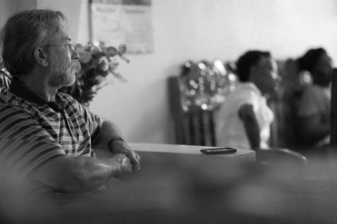 Allen Reesor listening to stories and experiences of restavek and restavek families.