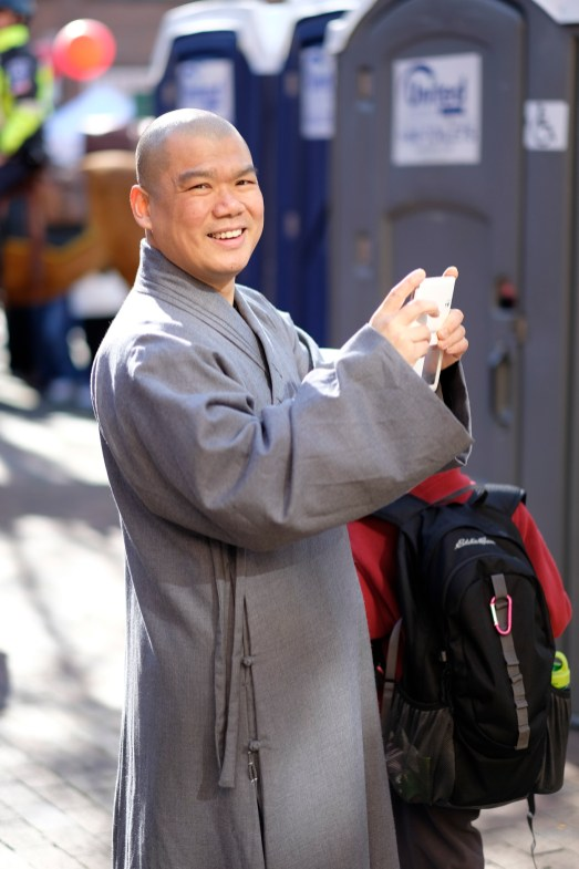 Monk with smartphone. He was about to take a picture when he saw me. He paused to smile at my camera. X-T1 / 56mm f1.2
