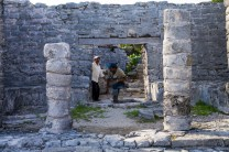 Man emerging from a hole where family members were buried (Tulum ruins)