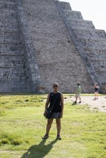 Carline with the north side of Kukulkan behind her.