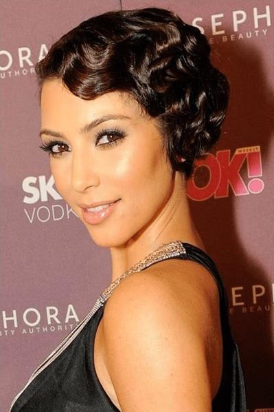Short Pixie Brunette Curly Hairstyle