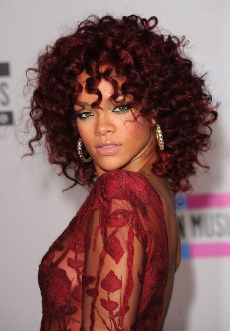 Red hair with curls reaching down to the shoulders