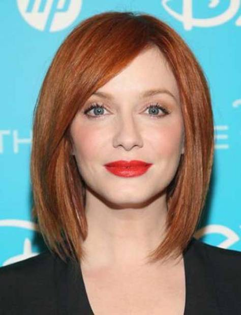 Medium long red bob with the hair shaped with pointed tips to frame the face