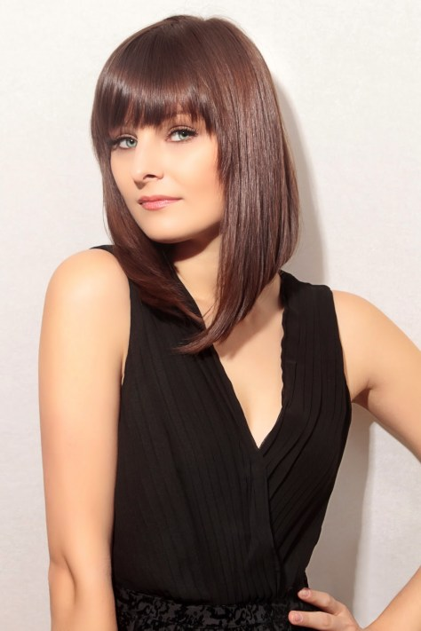 Modern A - line bob with bangs and ultra sleek straightness.