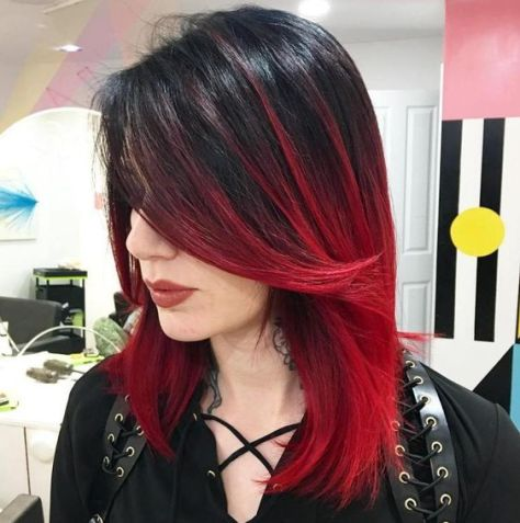 Two tone hairstyle with a combination of black and red hair.