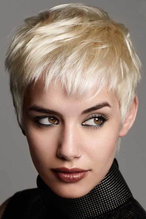 Short crop hairstyle with short bangs that open up the face.