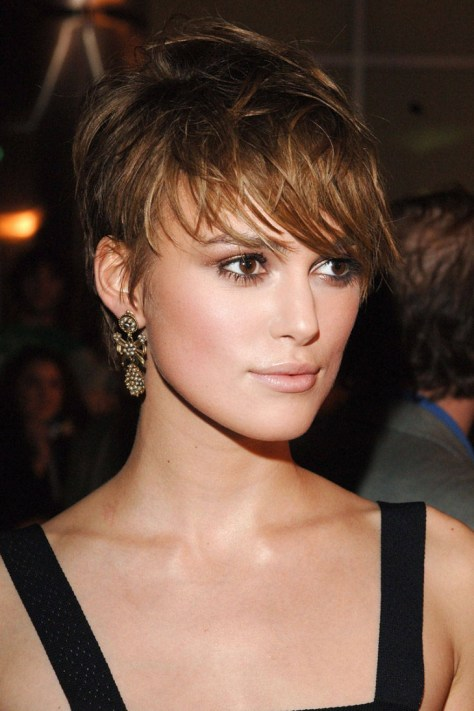 Feisty short hairstyle with minimal bangs to open up the face