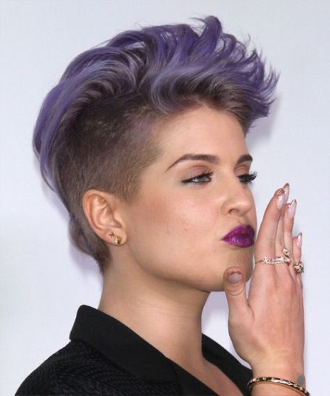 Short Tapered Hairstyle With Undercut Sections And A Diagonal Fringe