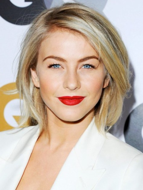 Dynamic short hairstyle with plenty of texture, great movement and a flamboyant color.