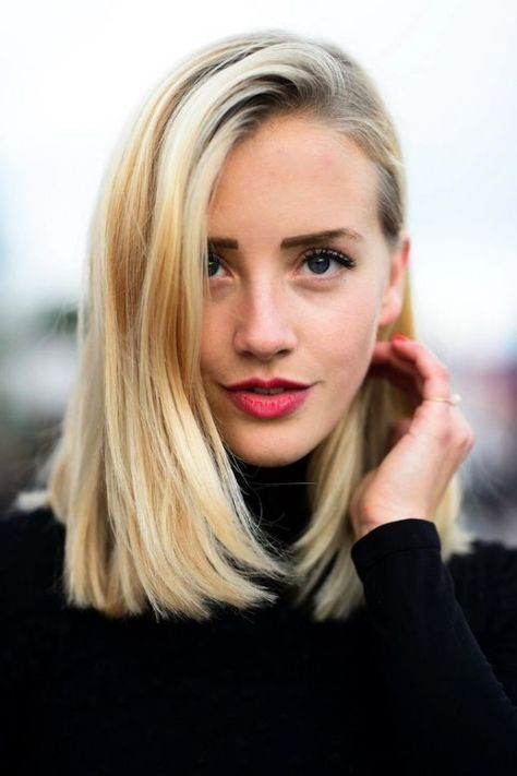 Long haircut with a straight cutting line and a side part