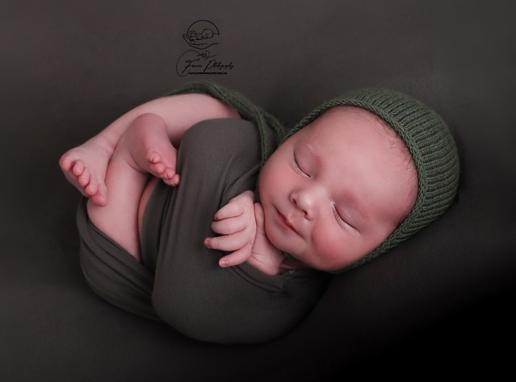 Brisbane newborn baby boy photographed wrapped up
