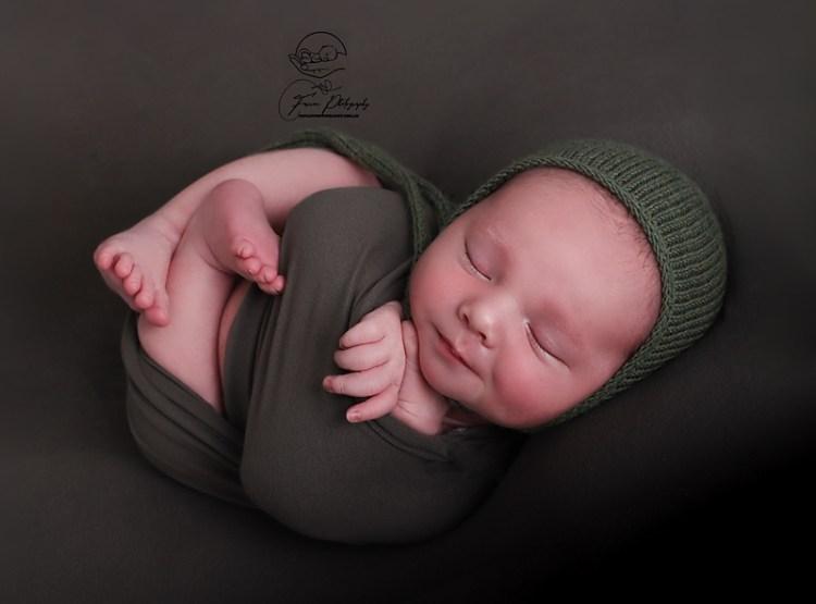 Brisbane newborn baby boy photographed wrapped up