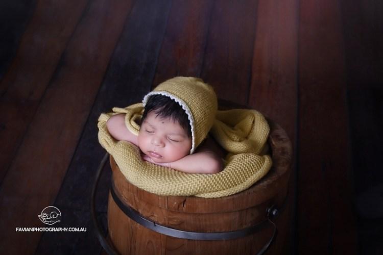 Baby girl in bucket cute posing