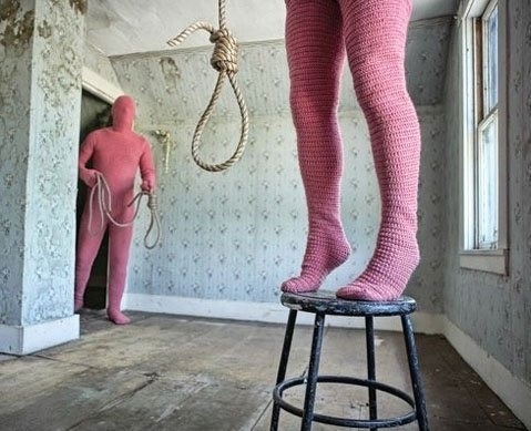 naked girl hung by noose
