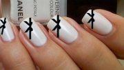 black bows white chanel nails