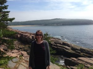 Elisabeth Schussler exploring the shores of Acadia National Park in Maine.