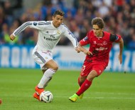 CARDIFF, WALES - Tuesday, August 12, 2014: Real Madrid's Cristiano Ronaldo in action against Sevilla during the UEFA Super Cup at the Cardiff City Stadium. (Pic by David Rawcliffe/Propaganda)
