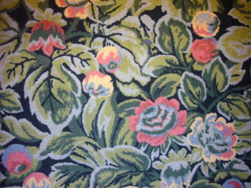 Green-toned, floral-patterned carpet
