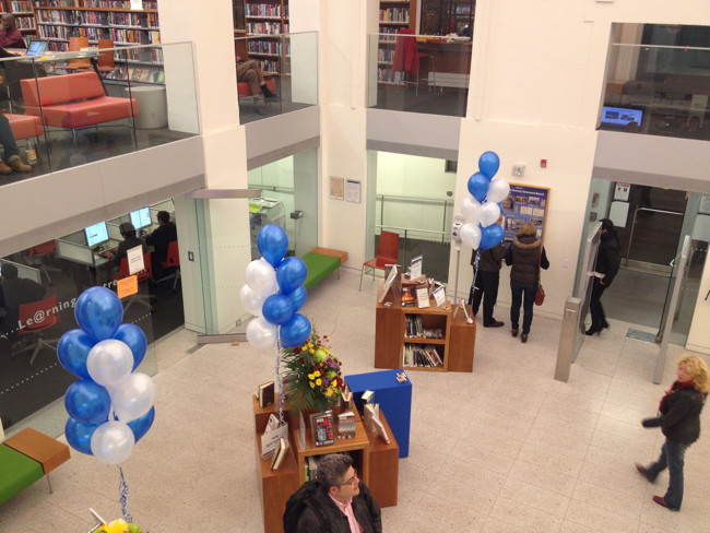 Overhead view of first floor of Bloor-Gladstone, with blue-and-white balloons affixed to displays