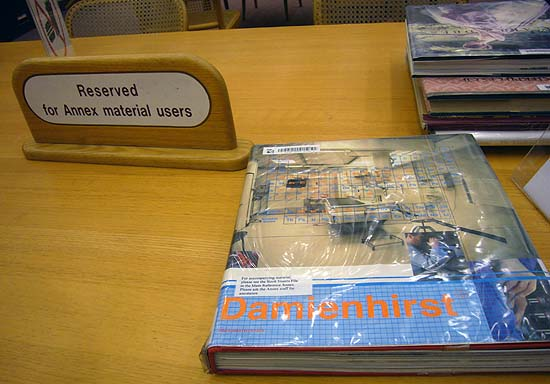 'Damienhirst' book on desk with sign reading Reserved for Annex material users
