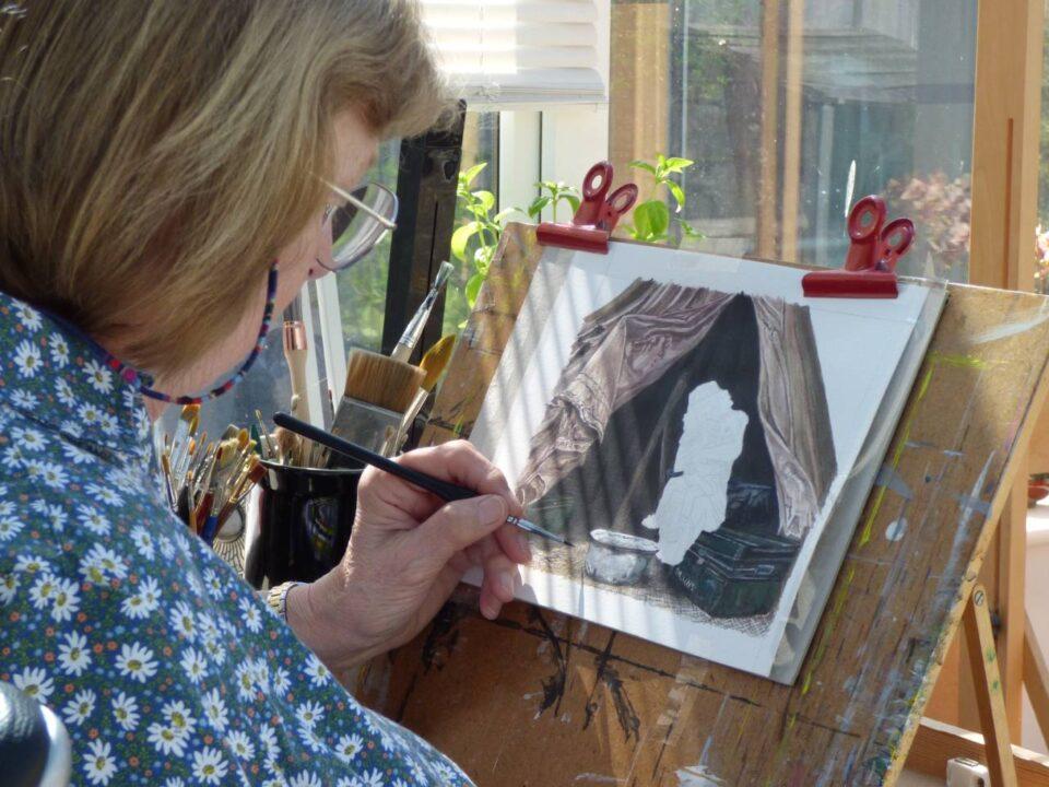 Faye Edmondson painting in her studio