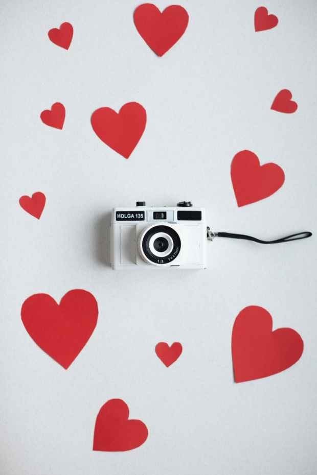 paper hearts with retro photo camera