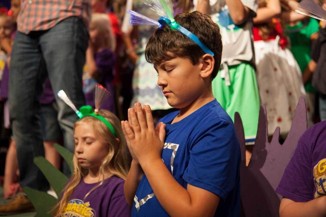 VBS boy praying