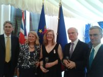 "Amanda DONNELLY-MARTIN (centre) with ""La Médaille d'Honneur pour Acte de Courage et de Dévouement"" invested by the Ambassador Bernard EMIĖ and the Minister of Defence Philip HAMMOND"