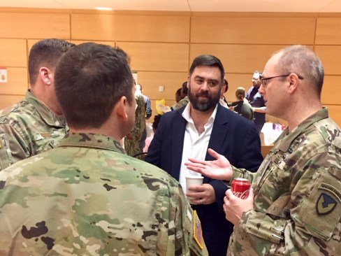FBR president, Matt Bailey in conversation with a few of the dedicated veterinarians and officers.