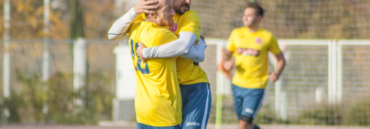 FCB midfielder Luigi Bosetti celebrating with captain Zak Harry after his second goal against Cervezas Mahou