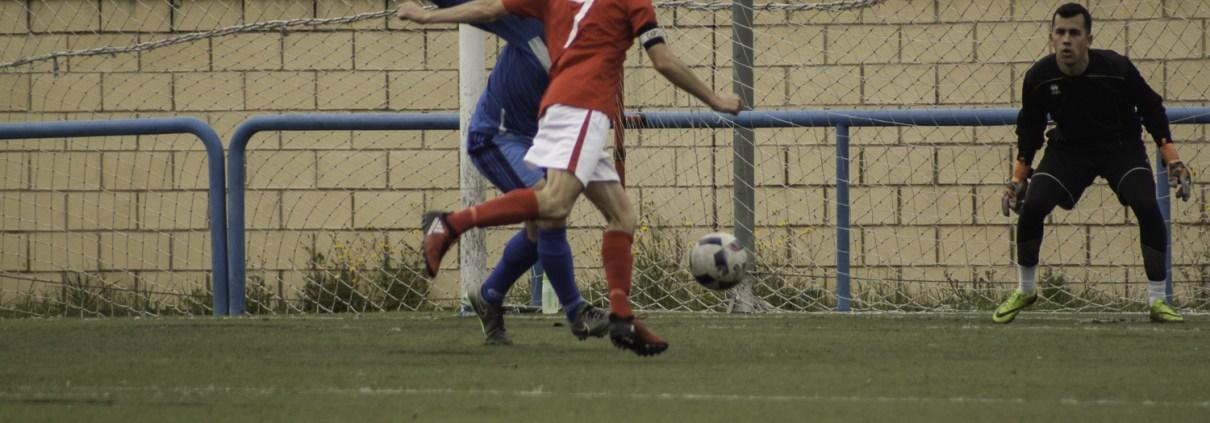 FCB captain and hatrick hero Ed KEith slots his 1st goal away against CD Banco de España