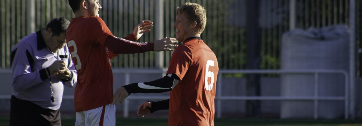 FCB's Ed KEith and Fabian Amdal Asland celebrate his 3rd goal of his hatrick against Bar La Rueda
