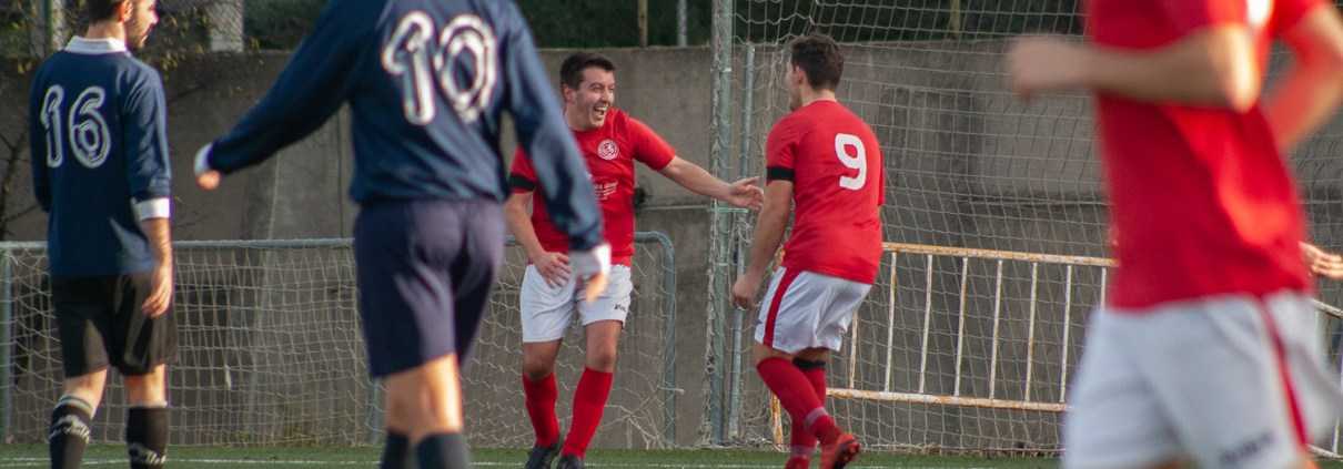 FC Britñanico goalscorer Craig Brignall celebrates his first goal against Bar Trampolín with striker Lewis Jones