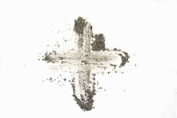 A cross with ashes is drawn against a white background.