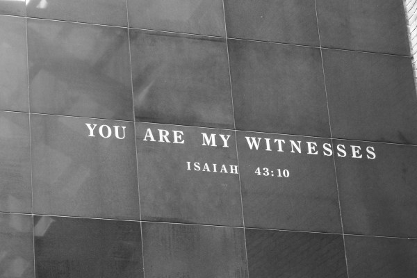"A black and white photo of a quote from Isaiah 43:10, ""You are my witnesses,"" etched into a stone-paneled wall at the United States Holocaust Memorial Museum. Image by hannahlmyers from Pixabay."