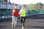Senior Adam Wallace finishes the 4x800 relay.