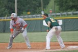 Junior Philip Archer tries picking off the base runner at first base.