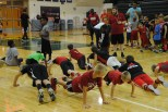 Campers do more push ups.
