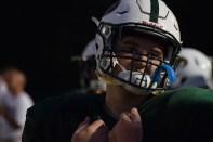 Junior Bryce Polk talks to his teammates on the sidelines.