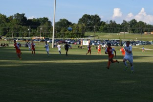 Junior Landon Campbell chases after the passed ball.