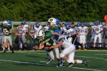 Senior Paden Pikey trys to break the tackle of a Charlestown player.