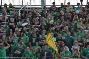 Students participate in the greenout for the scrimmage against Charlestown.
