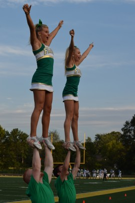 Junior Olivia Babbitt and senior Lindsey Suer get the crown excited about the game.
