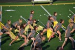 The members of the guard take their stance against the band members on the opposite side of the field. As a part of the theme, the guard and band face off in an epic battle of sorts.